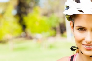 Young Woman Wearing Cycling Helmet At Park.
